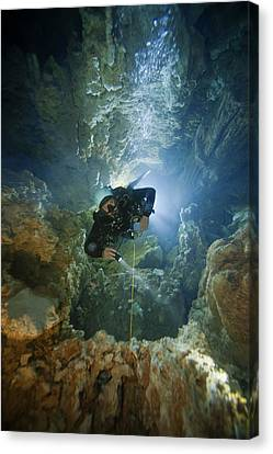 A Diver Ascends A Deep Shaft In Dans Canvas Print by Wes C. Skiles