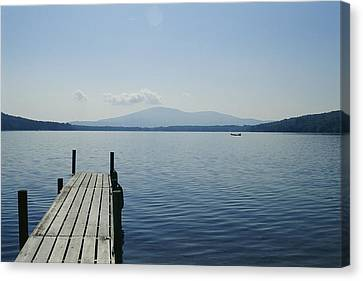 A Dock Juts Into The Canvas Print by Stacy Gold