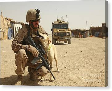 A Dog Handler Posts Security With An Canvas Print by Stocktrek Images