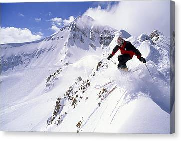 Mountain Men Canvas Print - A Downhill Skier Launching by Gordon Wiltsie