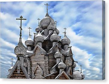 A Fragment Of A Wooden Christian Church With Domes In The Foreground Canvas Print by George Westermak