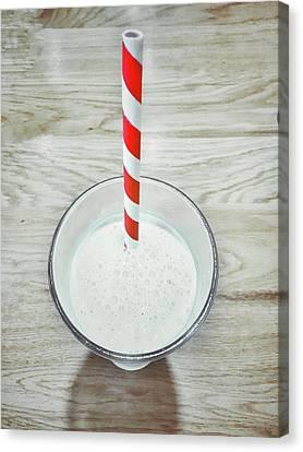 A Glass Of Milkshake Canvas Print by Tom Gowanlock