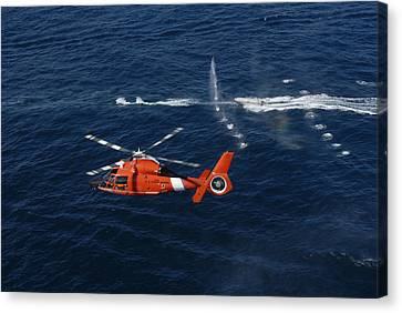 Law Enforcement Canvas Print - A Helicopter Crew Trains Off The Coast by Stocktrek Images