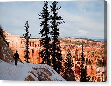 A Hiker Walks Along A Ledge In Winter Canvas Print by Taylor S. Kennedy