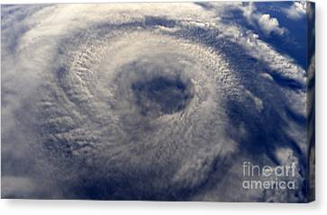 A Hurricane On Earth Viewed From Space Canvas Print by Caio Caldas