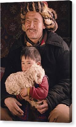 A Kazakh Eagle Hunter And His Son Canvas Print by David Edwards