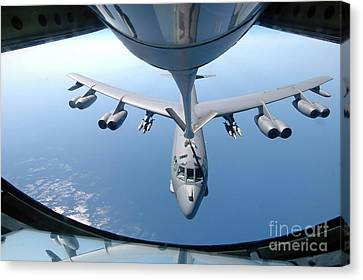 A Kc-135 Stratotanker Refuels A B-52 Canvas Print by Stocktrek Images