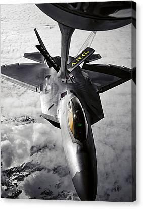 A Kc-135 Stratotanker Refuels A F-22 Canvas Print by Stocktrek Images