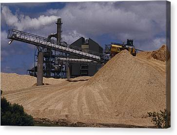A Logging Wood Chip Mill And A Tractor Canvas Print by Jason Edwards