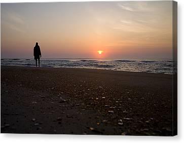 A Lone Figure Enjoys The Ocean Sunrise Canvas Print by Stephen St. John