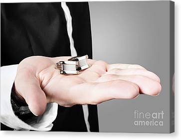 A Male Model Showcasing Cuff Links In His Hand Canvas Print by Jorgo Photography - Wall Art Gallery