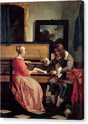 A Man And A Woman Seated By A Virginal Canvas Print by Gabriel Metsu