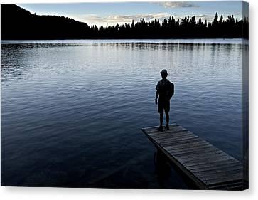 A Man Looking Across A Lake. Into Canvas Print by Dawn Kish
