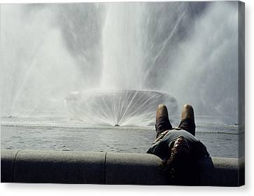 A Man Relaxes At A Fountain Canvas Print by Stacy Gold