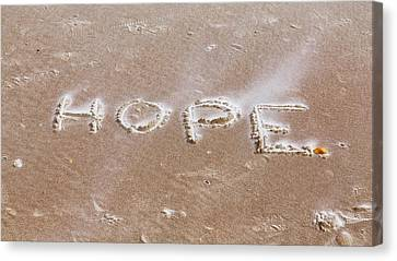 Canvas Print featuring the photograph A Message On The Beach by John M Bailey