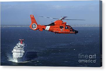 Law Enforcement Canvas Print - A Mh-65c Dolphin Helicopter by Stocktrek Images