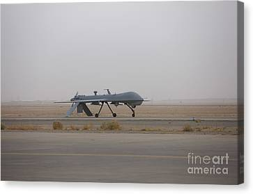 Iraq Canvas Print - A Mq-1c Warrior Taxis Out To The Runway by Terry Moore