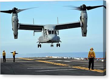 A Mv-22 Osprey Aircraft Prepares Canvas Print by Stocktrek Images