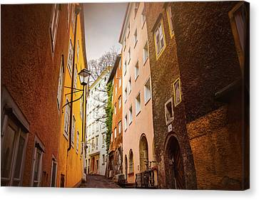 Buildings And Narrow Lanes Canvas Print - A Narrow Street In Salzburg  by Carol Japp