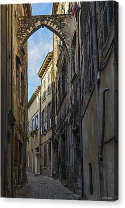 Canvas Print featuring the photograph A Narrow Street In Viviers by Allen Sheffield