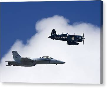 A Navy F-18 And A Wwii Vintage F4u Canvas Print by Medford Taylor