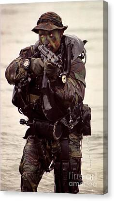 A Navy Seal Exits The Water Armed Canvas Print by Michael Wood