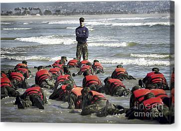 A Navy Seal Instructor Assists Students Canvas Print by Stocktrek Images