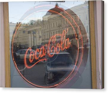 A Neon Coca Cola Sign Is Displayed Canvas Print by Richard Nowitz