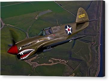 A P-40e Warhawk In Flight Canvas Print by Scott Germain