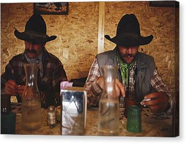 A Pair Of Cowboys Enjoy A Cup Of Coffee Canvas Print by Joel Sartore