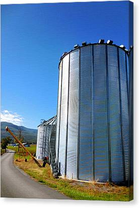 Feed Mill Canvas Print - A Pair Of Steel Grain Bins  2 by Lanjee Chee