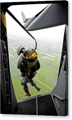 Backpack Canvas Print - A Paratrooper Executes An Airborne Jump by Stocktrek Images