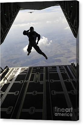 Romania Canvas Print - A Paratrooper Salutes As He Jumps by Stocktrek Images