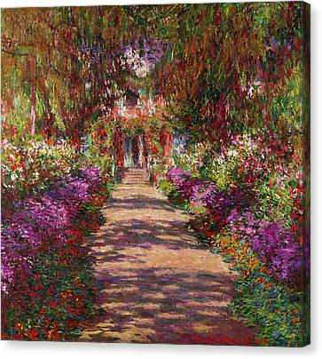 Impressionism Canvas Print - A Pathway In Monets Garden Giverny by Claude Monet