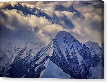 A Peak In The Clouds Canvas Print by Rick Berk