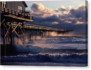 A Pier At Nags Head Is Pounded By Early Canvas Print by David Alan Harvey