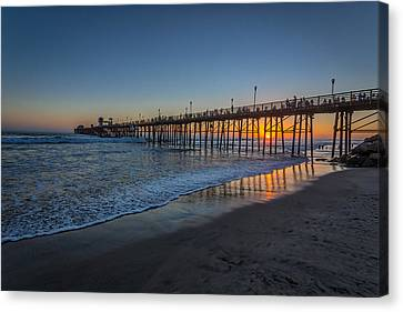 A Piers To Be Last Light Canvas Print by Peter Tellone