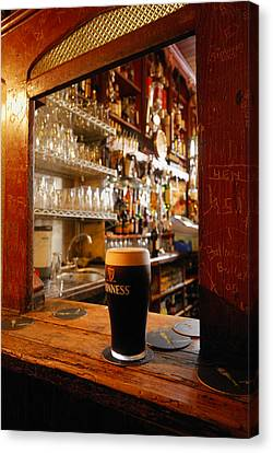 Local Food Canvas Print - A Pint Of Dark Beer Sits In A Pub by Jim Richardson