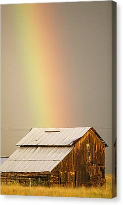 A Rainbow Arches From The Sky Onto Canvas Print by Michael S. Lewis
