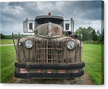 Canvas Print featuring the photograph A Really Rusty Ford by Guy Whiteley