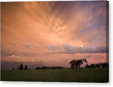 Cosmic And Atmospheric Phenomena Canvas Print - A Receding Thunderstorm Creates by Jim Richardson