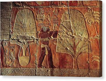 A Relief Of Men Carrying Myrrh Trees Canvas Print by Kenneth Garrett