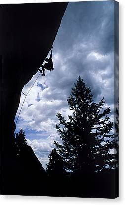A Rock Climber Ascends A Steep Route Canvas Print by Bill Hatcher