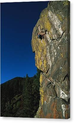 A Rock Climber Solo Climbs In Montanas Canvas Print by Gordon Wiltsie