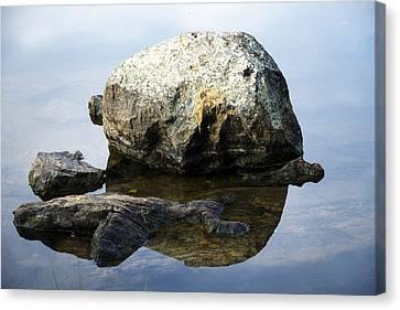 A Rock In Still Water Canvas Print