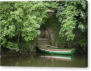 Row Boat Canvas Print - A Row Boat Roped At Some Stairs Along by John Short