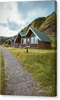 Canvas Print featuring the photograph A Row Of Cabins In Iceland by Edward Fielding