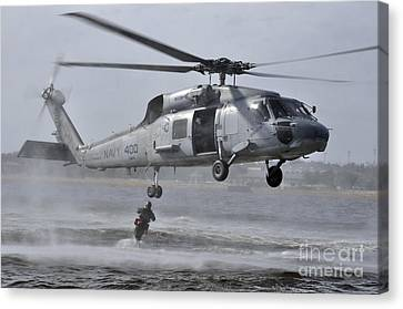 A Search And Rescue Swimmer Jumps Canvas Print by Stocktrek Images