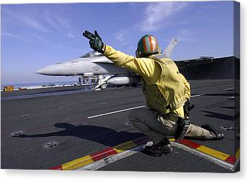 A Shooter Signals The Launch Of An Canvas Print by Stocktrek Images
