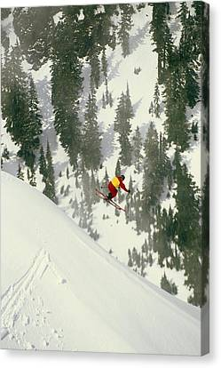 A Skier Jumps Off Of A Cliff Canvas Print by Gordon Wiltsie